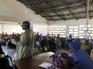 UNFPA Programme Analyst for Family Planning Commodity Security, Mr. Alieu Jammeh, giving a health talk on fistulas at Sinchu Baliya Health Post