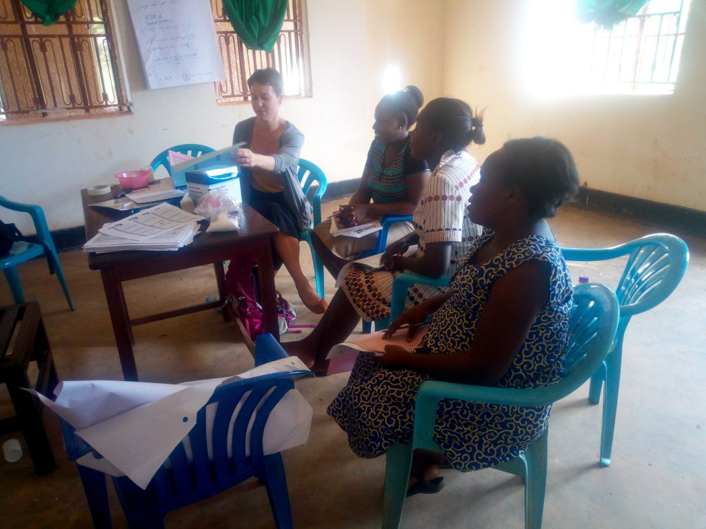 Conducting a training session with self-injection providers. (From left: Kirsten Miner, Violet Asiimwe, Lydia Namuganza, and Jaliya Nabirye.)