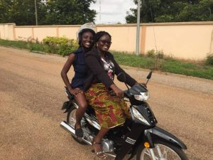 Me riding a motorbike for the first time with the help of Genevieve. Motorbikes are a common mode of transport in Tamale, and it was only right that I learn to ride one while there.
