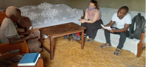 Meeting with a VHT from Rwakingi IA Village to discuss SCD and the reason for our survey. Both permission for photo and the explanation for its use was given before photo was taken
