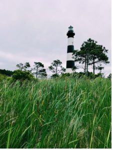 Lighthouse from a grassy area.