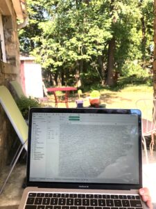 A map of North Carolina on a laptop in Jaclyn's backyard.