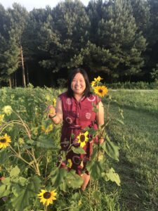 Melissa in a field of sunflowers at the NC Museum of Art.